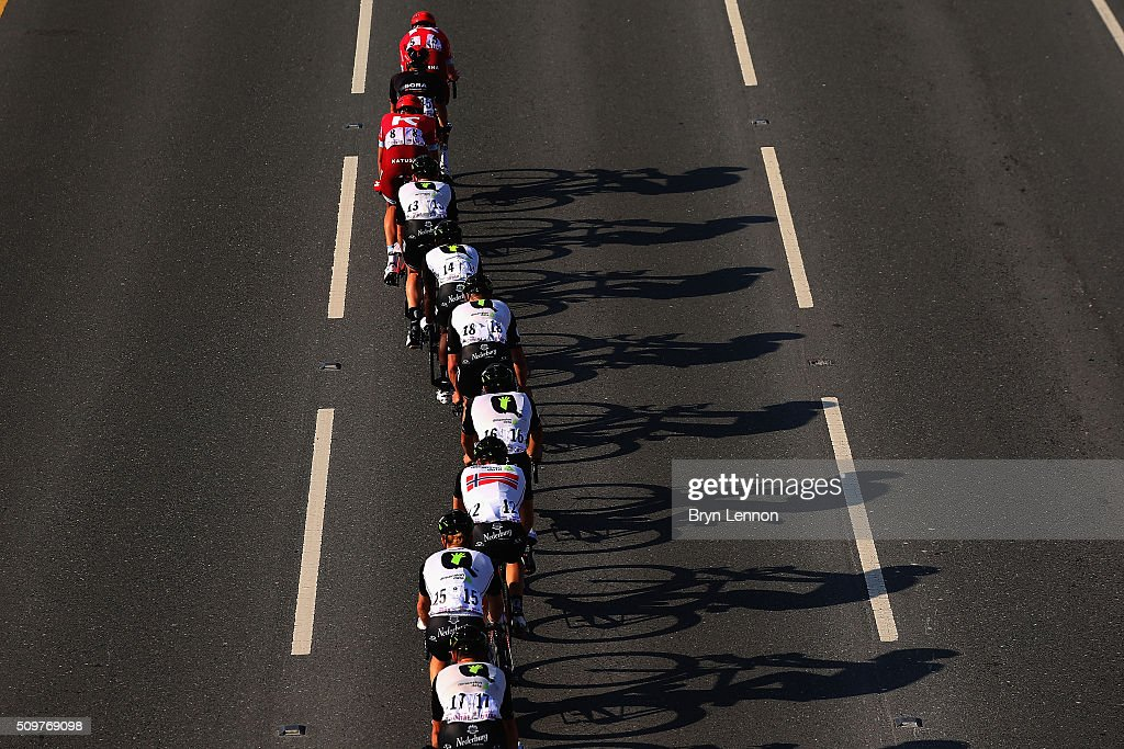 The peloton passes under a bridge on stage five of the 2016 Tour of Qatar, a 114.5km road stage from Sealine Beach Resort to Doha Corniche, on February 12, 2016 in Doha, Qatar