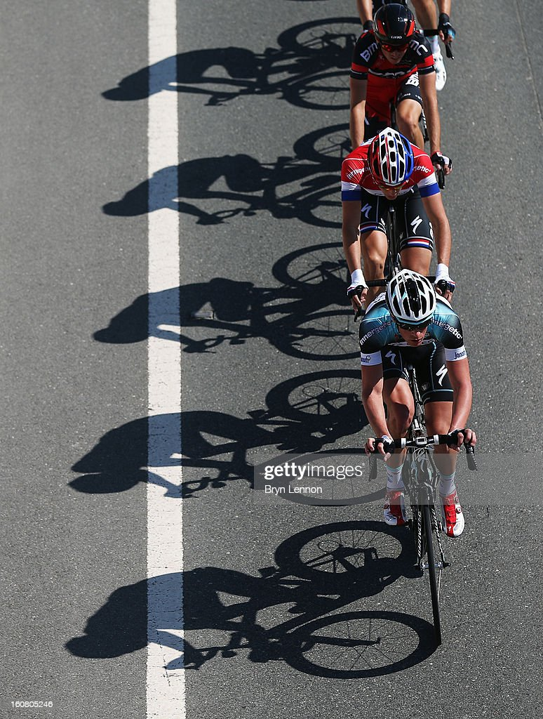 The peloton passes under a bridge on stage four of the Tour of Qatar from Camel Race Track to Al Khor Corniche on February 6, 2013 in Al Khor Corniche, Qatar.