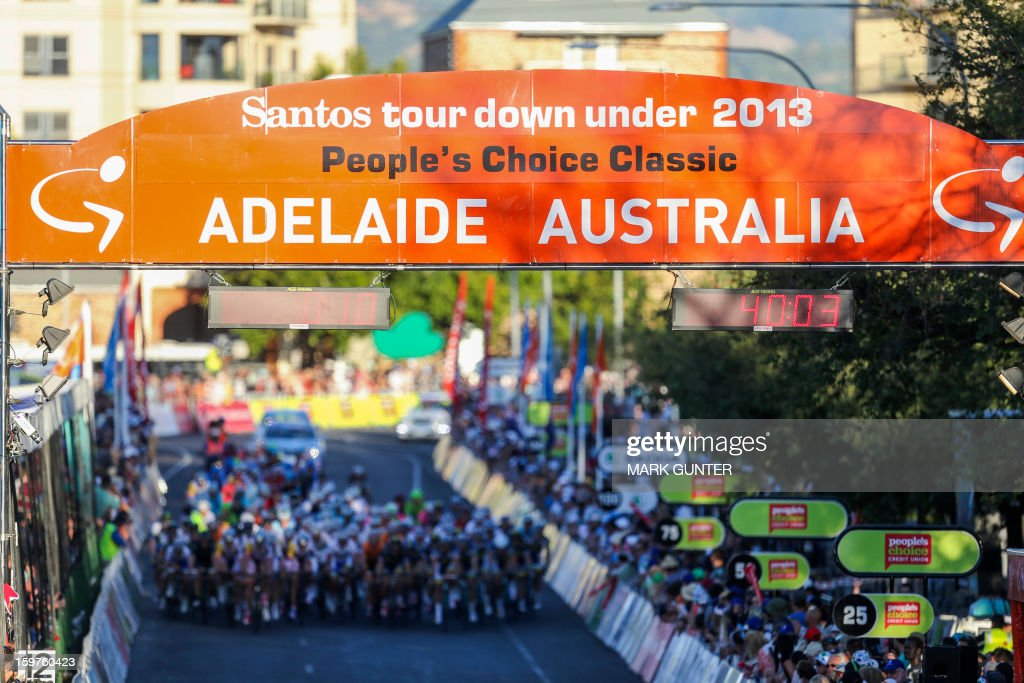 The peloton races during the 51km People's Choice Classic prior to the Tour Down Under in Adelaide on January 20, 2013. The six-stage Tour Down Under takes place from January 20 to 27. AFP PHOTO / Mark Gunter USE
