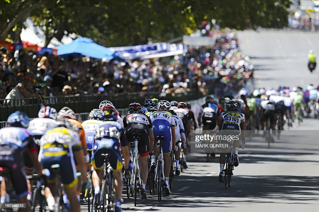 The peloton races during the 90-km stage 6 around the streets of Adelaide on the final day of the Tour Down Under cycling race on January 27, 2013. AFP PHOTO / Mark Gunter USE