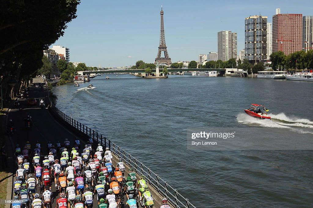The peloton races into Paris alongside the river during the twentieth and final stage of the 2012 Tour de France, from Rambouillet to the Champs-Elysees on July 22, 2012 in Paris, France.