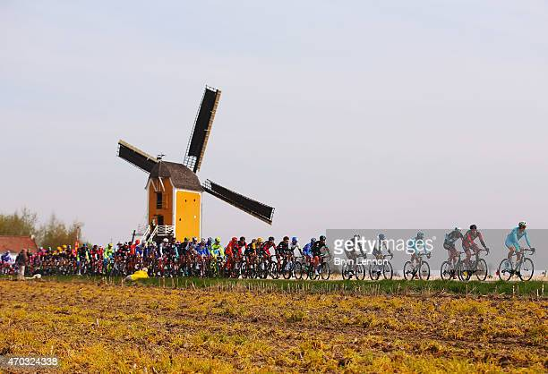 The peloton races past a windmill during the 50th edition of the Amstel Gold Race on April 19 2015 in Maastricht Netherlands The 251km route from...