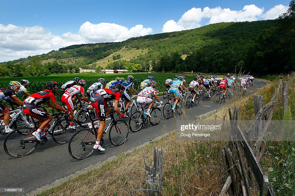 The peloton races through the countryside during stage fourteen of the 2012 Tour de France from Limoux to Foix on July 15, 2012 in La Bastide Sur-L'Hers, France.