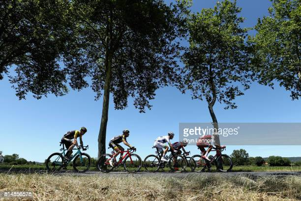 The peloton ride past a field during stage 14 of the Le Tour de France 2017 a 181km stage from Blagnac to Rodez on July 15 2017 in Rodez France