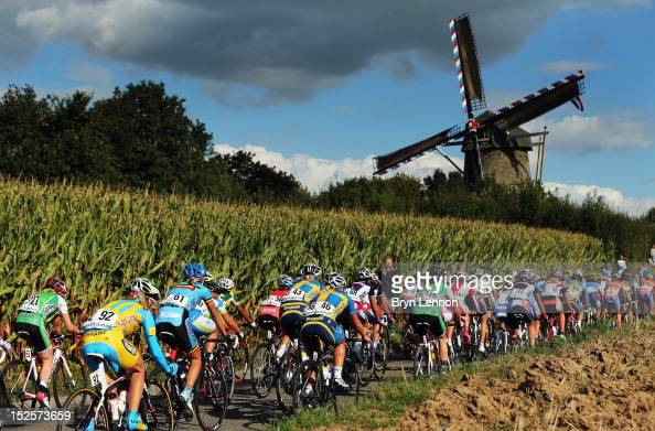 The peloton ride past a windmill during the Elite Women's Road Race on day seven of the UCI Road World Championships on September 22 2012 in...