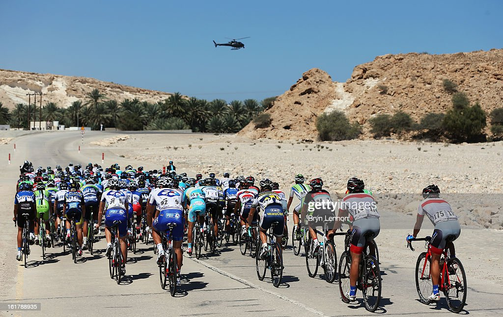 The peloton ride through Oman countryside on stage six of the 2013 Tour of Oman from Hawit Nagam Park to the Matrah Corniche on February 16, 2013 in Matrah, Oman.