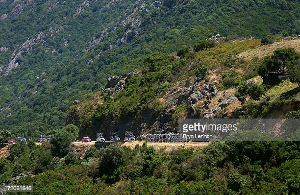 The peloton ride through the Corsican countryside during stage three of the 2013 Tour de France a 1455KM road stage from Ajaccio to Calvi on July 1...