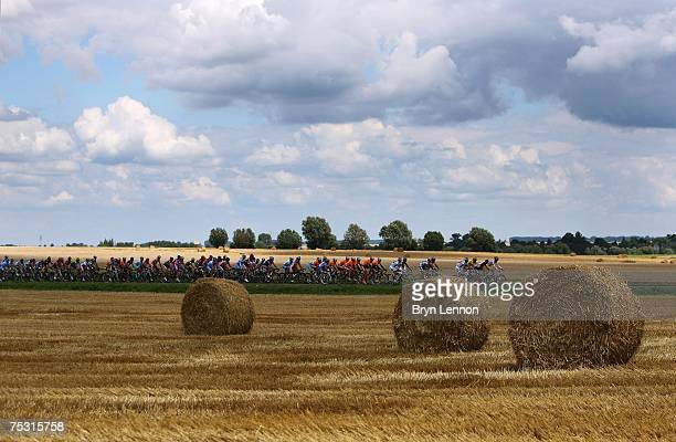 The Peloton ride through the French countryside during stage 3 of the 2007 Tour de France from Waregem to Compiegne on July 10 2007 in Compiegne...