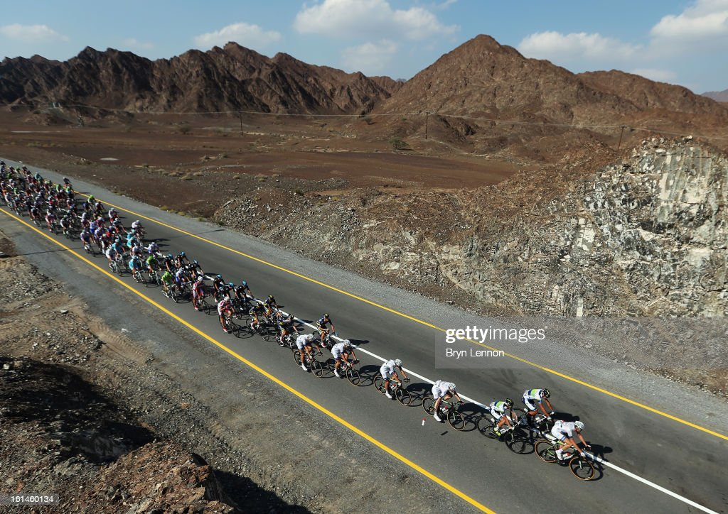 The peloton ride through the Oman countryside during stage one of the 2013 Tour of Oman from Al Musannah to Sultan Qaboos University on February 11, 2013 in Muscat, Oman.
