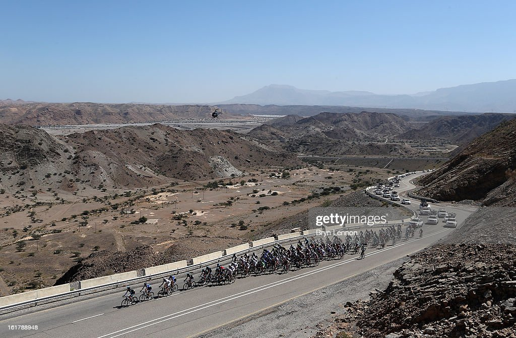 The peloton ride through the Oman countryside on stage six of the 2013 Tour of Oman from Hawit Nagam Park to the Matrah Corniche on February 16, 2013 in Matrah, Oman.
