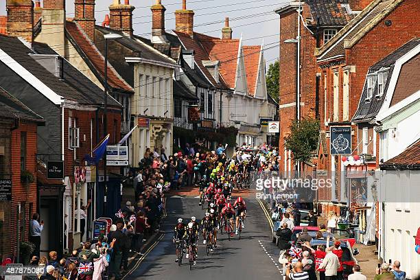 The peloton ride through Wymondham during stage seven of the 2015 Tour of Britain from Fakenham Racecourse to Ipswich on September 12 2015 in...
