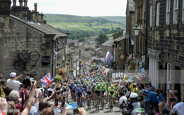 The Peloton ride up Haworth High Street during Stage Two of Le Tour de France on July 6 2014 in Haworth England