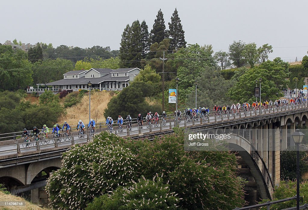 The peloton rides across a bridge during stage three of the 2011 AMGEN Tour of California from Auburn to Modesto on May 17 2011 in Folsom California