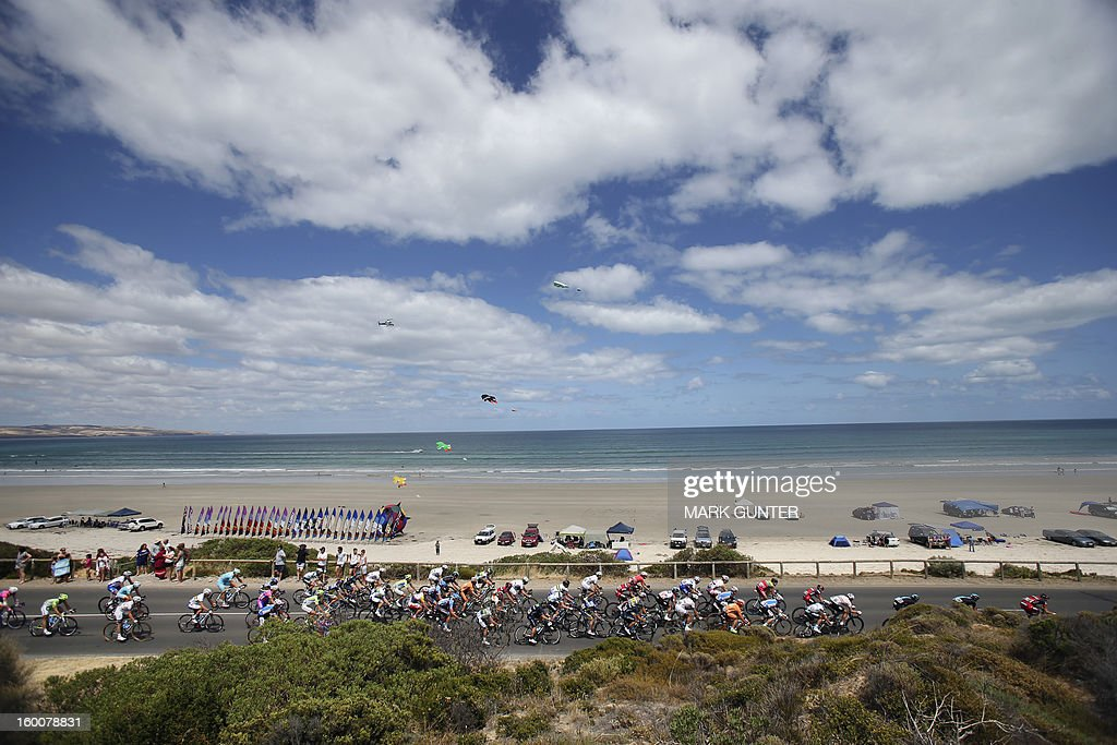 The peloton rides along side Aldinga Beach during the 151.5-km stage 5 of the Tour Down Under in Adelaide on January 26, 2013. The six-stage Tour Down Under is taking place from January 20 to 27. AFP PHOTO / Mark Gunter USE