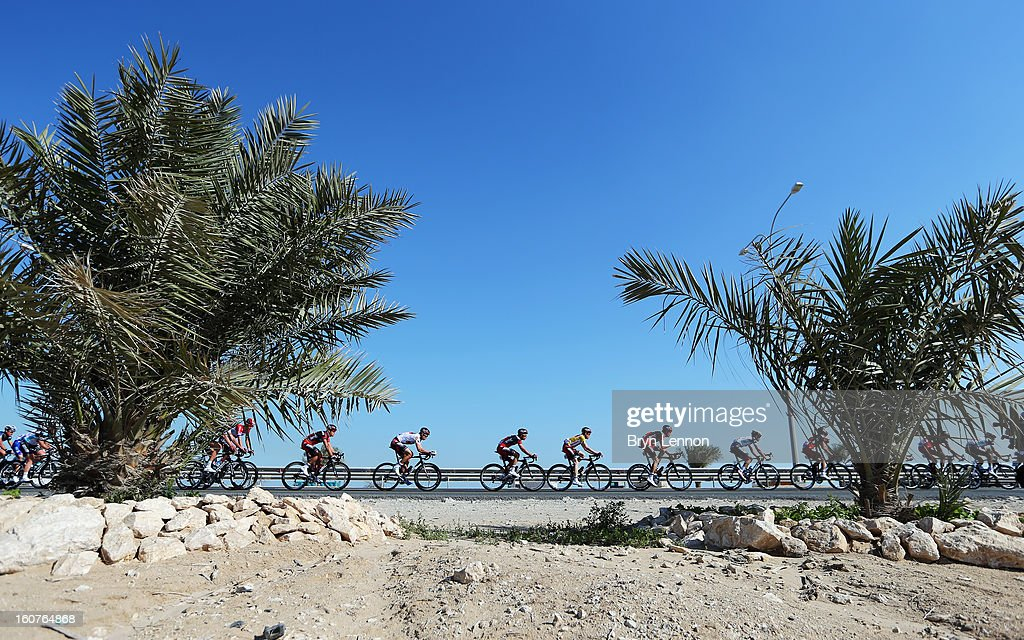 The peloton rides along the roads of Qatar during stage three of the Tour of Qatar from Alwakra to Mesaieed on February 5, 2013 in Doha, Qatar.