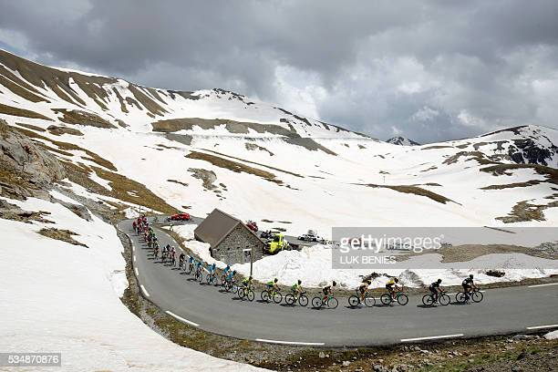 The peloton rides at the La Bonette pass during the 20th stage of the 99th Giro d'Italia Tour of Italy from Guillestre to Sant'Anna di Vinadio on May...