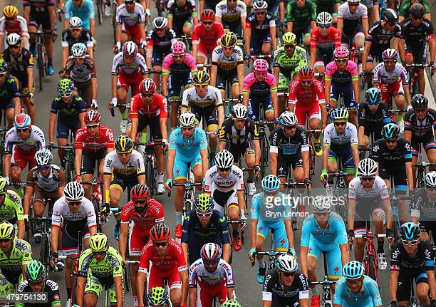 The peloton rides at the start of stage four of the 2015 Tour de France a 2235km stage between Seraing and Cambrai on July 7 2015 in Seraing Belgium