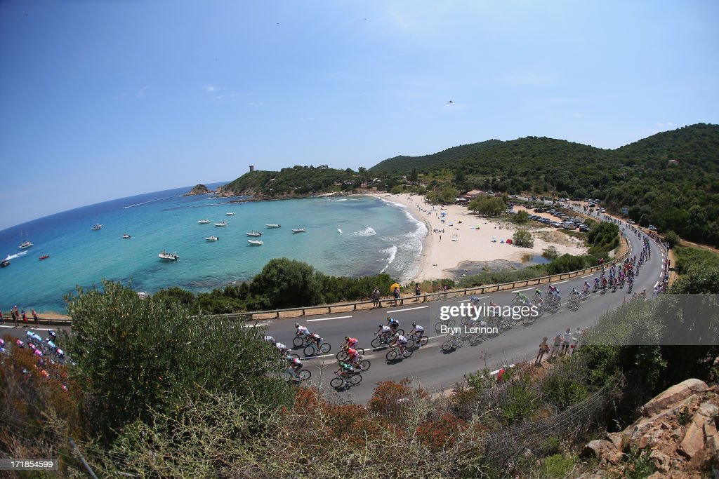 The peloton rides by the coast during stage one of the 2013 Tour de France, a 213KM road stage from Porto-Vecchio to Bastia, on June 29, 2013 near Sari-Solenzara, France.