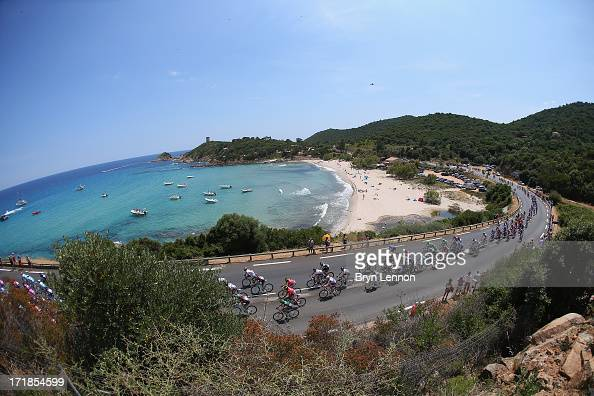 The peloton rides by the coast during stage one of the 2013 Tour de France a 213KM road stage from PortoVecchio to Bastia on June 29 2013 near...
