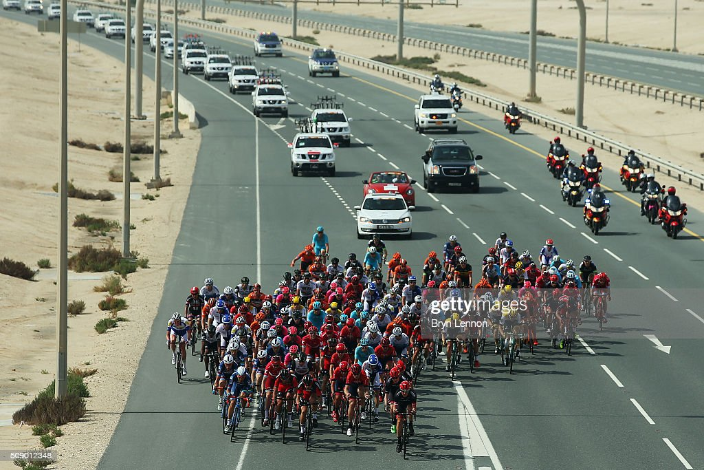 The peloton rides down a Qatar highway during stage one of the 2016 Tour of Qatar, a 176.5km road stage from Durkhan to Al Khor Corniche on February 8, 2016 in Al Khor Corniche, Qatar.