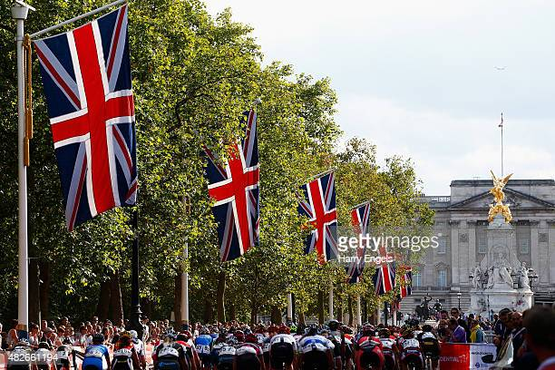 The peloton rides down The Mall during the Ride London Women's Grand Prix in St James's Park on August 1 2015 in London England