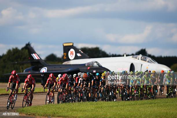 The peloton rides down the runaway at Wattisham Airfield during stage seven of the 2015 Tour of Britain from Fakenham Racecourse to Ipswich on...