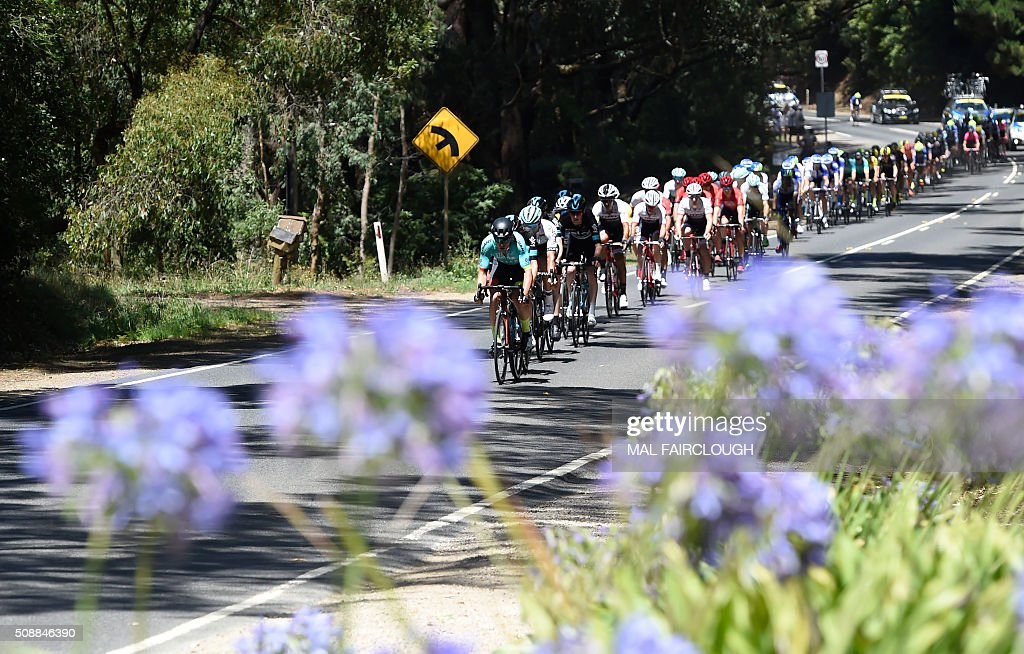 The peloton rides during stage four of the 2016 Herald Sun Tour cycling race at Arthurs Seat in Victoria on February 7, 2016. AFP PHOTO / MAL FAIRCLOUGH FAIRCLOUGH