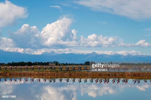 The peloton rides during the 14th stage of the 100th Giro d'Italia Tour of Italy cycling race from Castellania to Oropa on May 20 2017 / AFP PHOTO /...