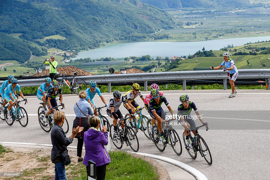 The peloton rides during the 16th stage of the 99th Giro d'Italia, Tour of Italy, from Bressanone / Brixen to Andalo on May 24, 2016. Dutchman Steven Kruijswijk moved closer to a history-making Giro d'Italia triumph Tuesday after stretching his lead over Esteban Chaves and Vincenzo Nibali in a thrilling 16th stage won by Alejandro Valverde. / AFP / LUK