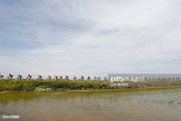 TOPSHOT The peloton rides during the 18th stage of the 99th Giro d'Italia Tour of Italy from Muggio to Pinerolo on May 26 2016 AFP PHOTO / LUK BENIES...