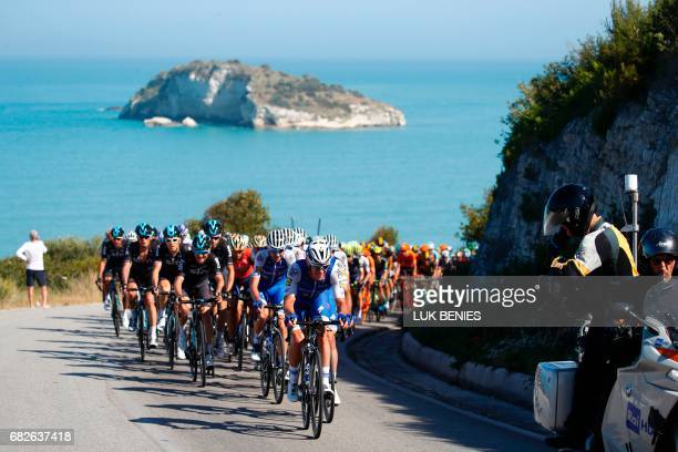 The peloton rides during the 8th stage of the 100th Giro d'Italia Tour of Italy cycling race from Molfetta to Peschici on May 13 2017 / AFP PHOTO /...
