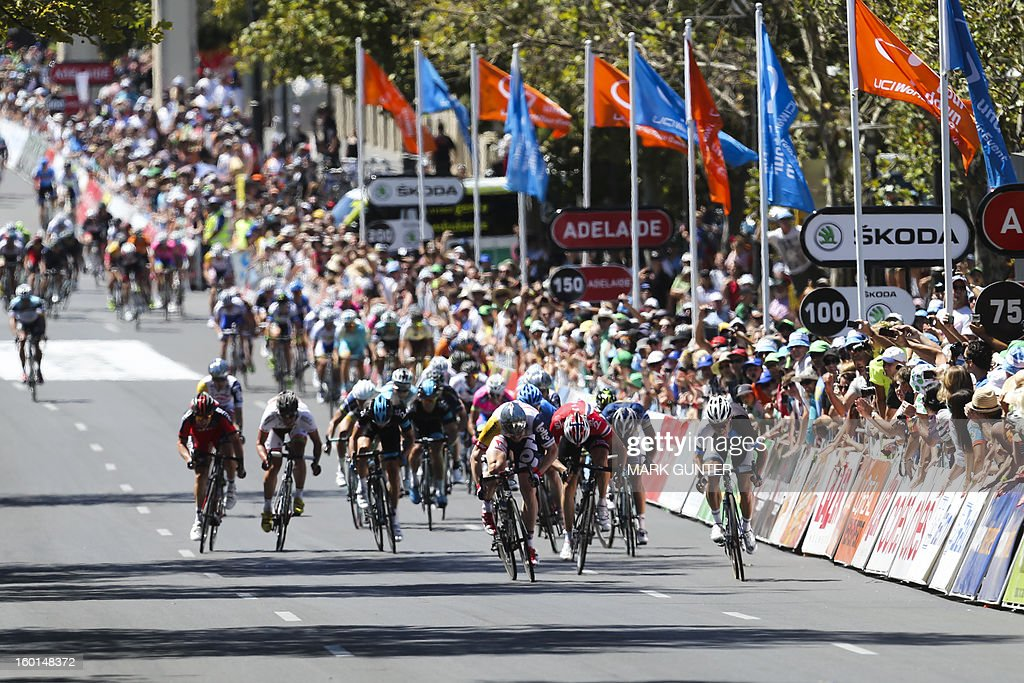 The peloton rides during the final sprint of the 90-km stage 6 around the streets of Adelaide on the final day of the Tour Down Under cycling race in Adelaide on January 27, 2013. AFP PHOTO / Mark Gunter USE