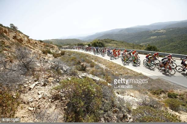 TOPSHOT The peloton rides during the second stage of the 100th Giro d'Italia Tour of Italy from Olbia to Tortoli on May 6 2017 in Sardinia / AFP...