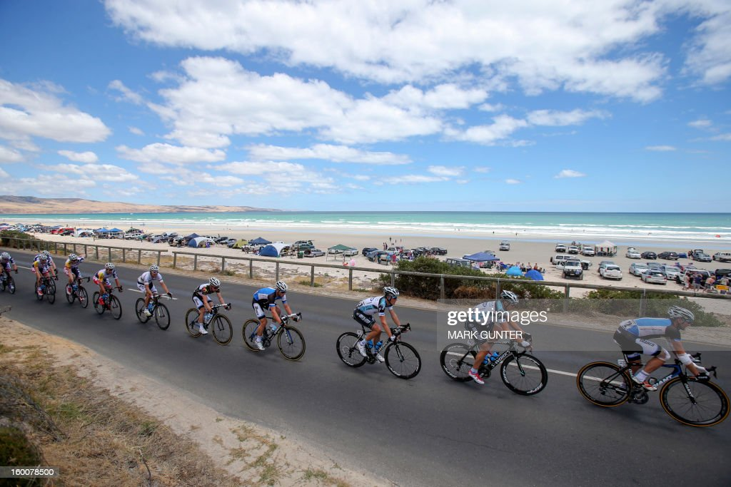 The peloton rides in front of Aldinga Beach during the 151.5-km stage 5 of the Tour Down Under in Adelaide on January 26, 2013. The six-stage Tour Down Under is taking place from January 20 to 27. AFP PHOTO / Mark Gunter USE