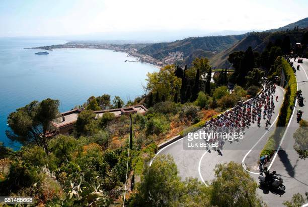 TOPSHOT The peloton rides near Taormina during the 5th stage of the 100th Giro d'Italia Tour of Italy cycling race from Pedara to Messina on May 10...