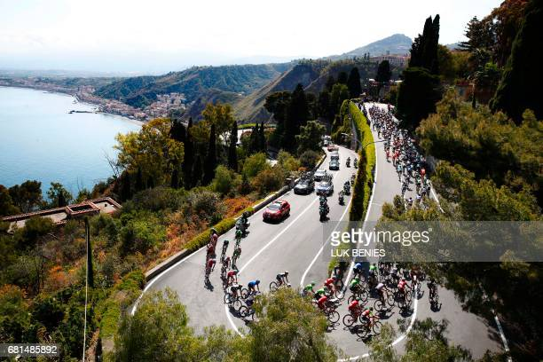 The peloton rides near Taormina during the 5th stage of the 100th Giro d'Italia Tour of Italy cycling race from Pedara to Messina on May 10 2017 in...