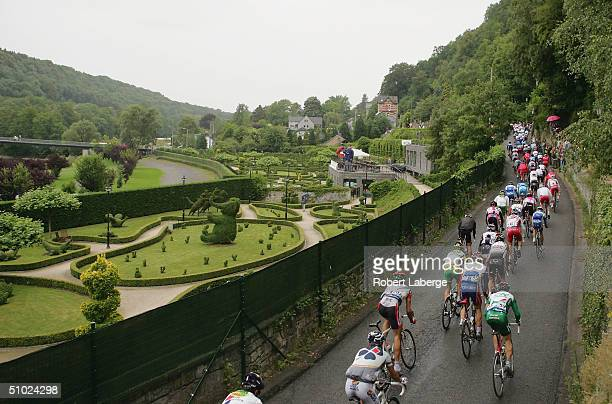The Peloton rides out of the Durbuy village during Stage 1 of the Tour de France between Liege and Charleroi on July 4 2004 in Durbuy Belgium