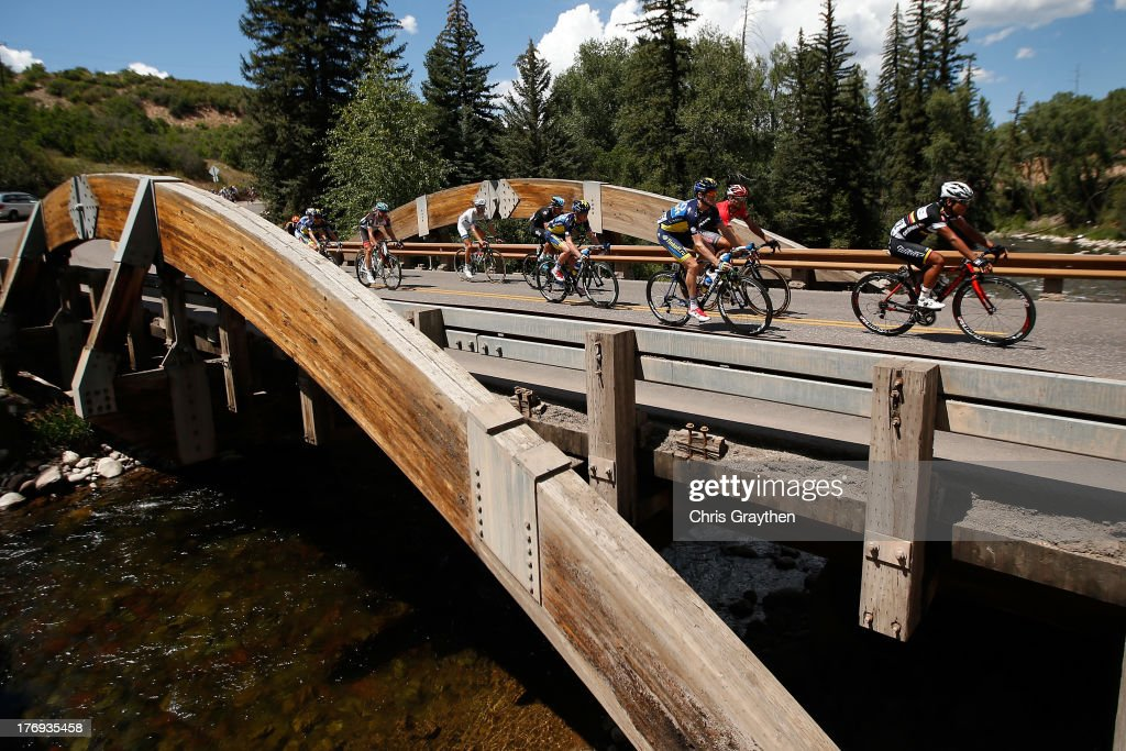 The peloton rides over a bridge during stage one of the USA Pro Cycling Challenge on August 19, 2013 in Aspen, Colorado.