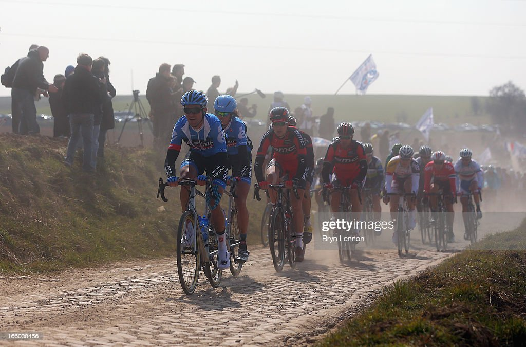 The peloton rides over the unmade roads of the 2013 Paris - Roubaix race from Compiegne to Roubaix on April 7, 2013 in Roubaix, France. The 111th Paris - Roubaix race is 254km long and contains 27 sections of cobblestones.
