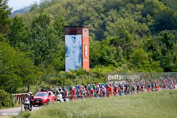The peloton rides past a giant picture of Italian legend Fausto Coppi during the 14th stage of the 100th Giro d'Italia Tour of Italy cycling race...
