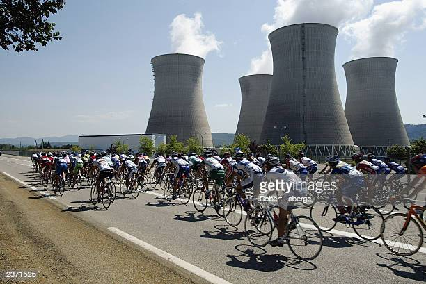 The peloton rides past a nuclear power plant during stage seven between Lyon and MorzineAvoriaz of the Tour de France on July 12 2003 in France