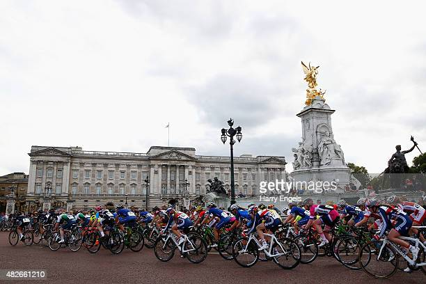 The peloton rides past Buckingham Palace during the Ride London Women's Grand Prix in St James's Park on August 1 2015 in London England