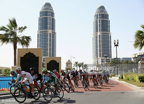 The peloton rides past during the Junior Men's Road Race on Day Six of the UCI Road World Championships at The Pearl on October 14 2016 in Doha Qatar