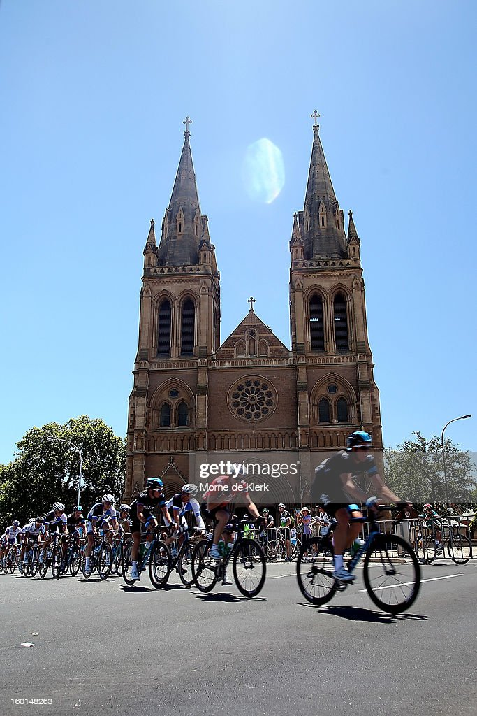 The peloton rides past St Peter's Cathedral in North Adelaide during stage six of the Tour Down Under on January 27, 2013 in Adelaide, Australia.