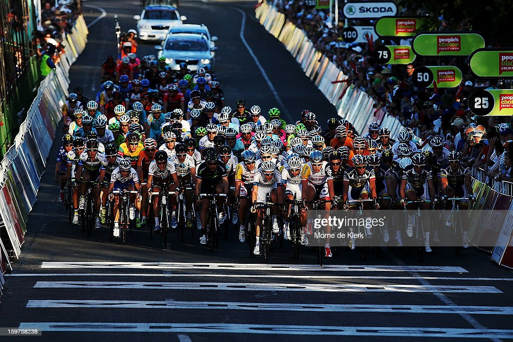 The peloton rides though the start/finish line during the People's Choice Classic race of the Tour Down Under on January 20, 2013 in Adelaide, Australia.
