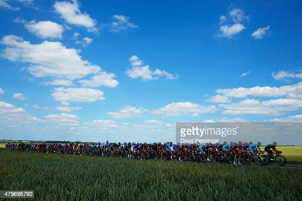 The peloton rides through the Belgian countryside during stage three of the 2015 Tour de France a 1595 km stage between Anvers and Huy on July 6 2015...