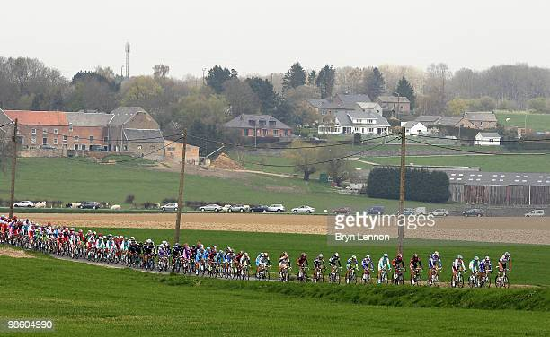 The peloton rides through the Belgian countryside during the 74th Fleche Wallonne Race on April 21 2010 in Huy Belgium