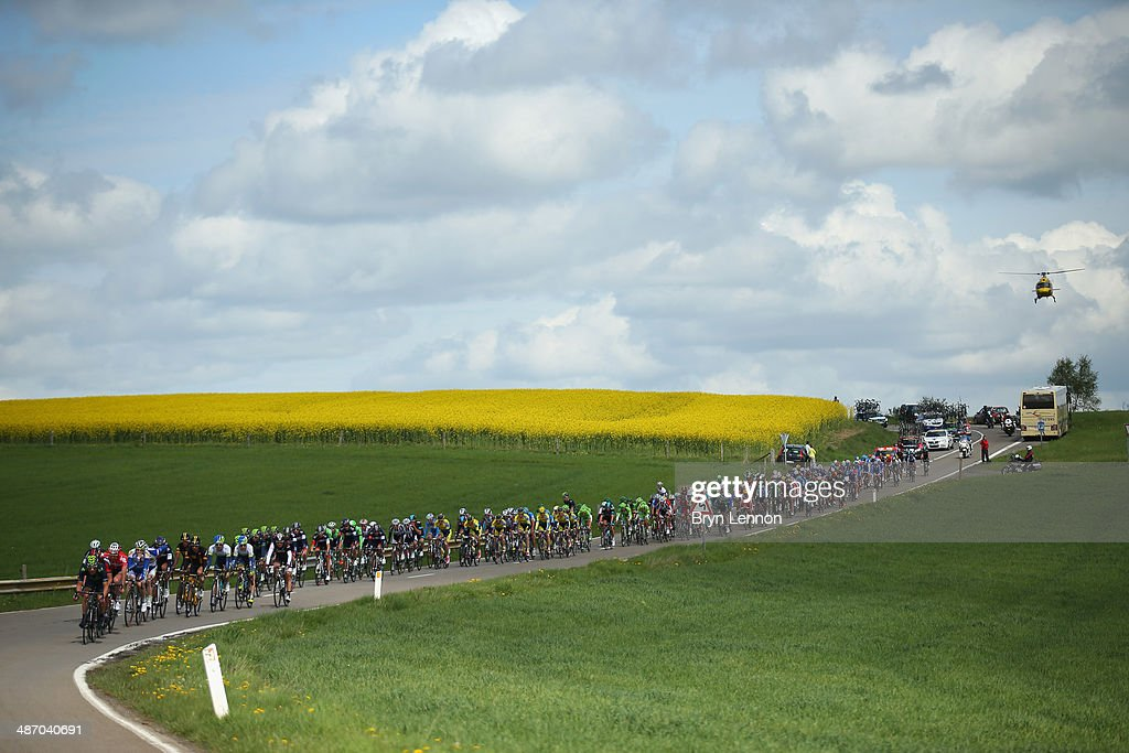 The peloton rides through the Belgian countryside towards Bastogne during the 100th edition of the LiegeBastogneLiege road race on April 27 2014 in...