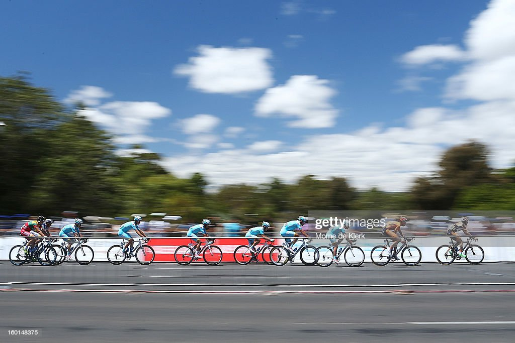 The peloton rides through the circuit during stage six of the Tour Down Under on January 27, 2013 in Adelaide, Australia.