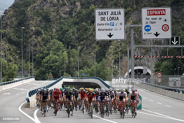 The peloton rides through the city during stage nine of the 2016 Le Tour de France a 1845km stage from Vielha Val d'Aran to Andorre Arcalis at on...